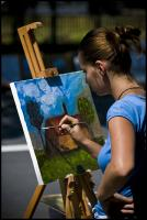 Woman painting landscape