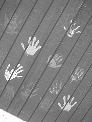 hand prints on a fence
